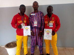 Bah Amadou Sadigou président de la fédération guinéenne de Sambo et Boxe chinoise(FGSBC) avec des médaillés guinéens
